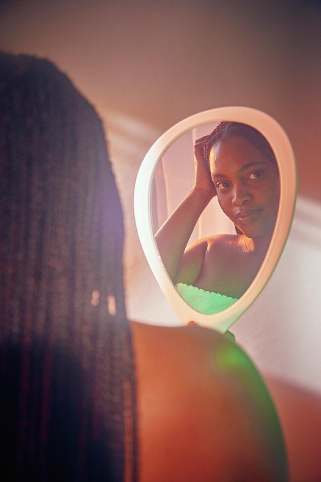 powerful woman looking through mirror